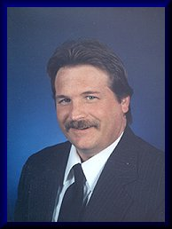 Neil Pluister, Minocqua Wisconsin real estate Re/Max Property Pros Realtor/Broker Associate.